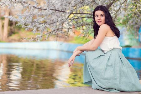 flourishing: Romantic woman in a spring flourishing park Stock Photo
