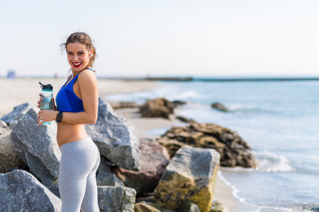 working out: Woman working out at the beach Stock Photo