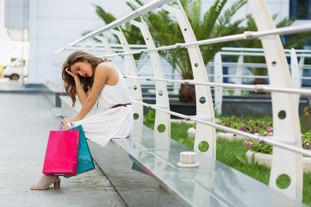 consumerism: Stylish woman shopping in the city Stock Photo