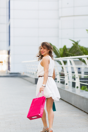 Stylish woman shopping in the summer city
