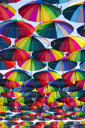 ar: Multicolor umbrellas hanging in the ar. Abstract background