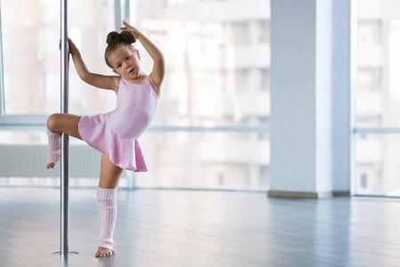 Adorable girl dancer in the ballet studio Stock fotó