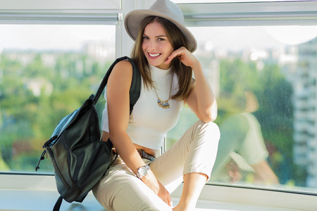 Stylish boho woman with a leather backpack Stockfoto