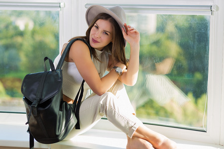 rucksack ': Stylish boho woman with a leather backpack Stock Photo