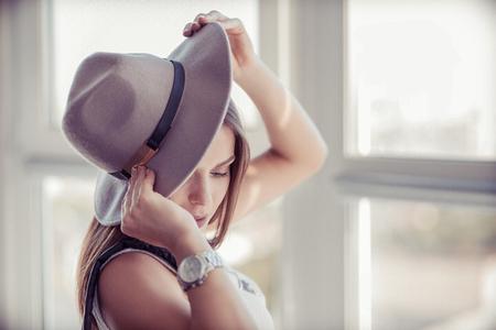Beautiful boho woman with a stylish wool hat