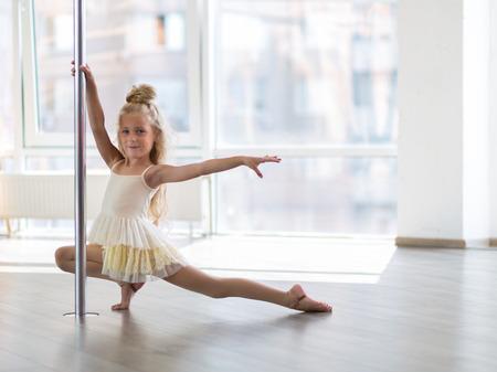 Beautiful little girl dancing in a dpole dance studio Stock fotó