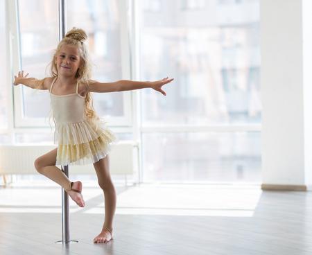 the poles: Beautiful little girl dancing in a dpole dance studio Stock Photo
