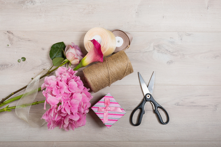 card making: Lovely bouquet in a flower shop on a wooden background Stock Photo