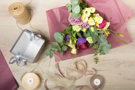 floristic: Flowers and floristic equipment arranged on a wooden background