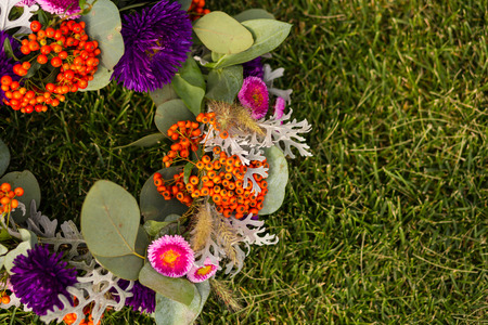 Beautiful autumn flower crown laying on the ground Stock Photo