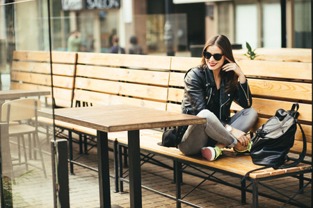 rucksack ': Stylish woman on a city street at summer day Stock Photo