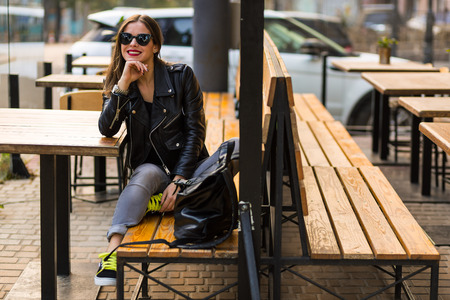 Stylish woman on a city street at summer day Stock Photo