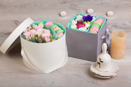 flower box: Flower box with macaron cookies on a wooden background Stock Photo