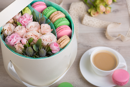 Flower box with macaron cookies on a wooden background Stock Photo