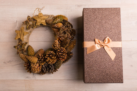 pinecones: Holiday wreath made of pine cones in golden tone