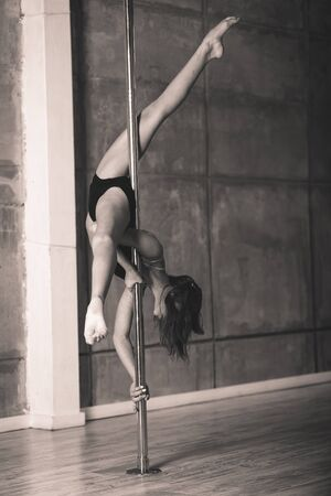 girl working out: Pretty pole dancer girl working out in the studio