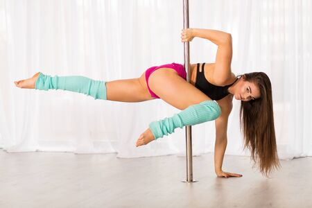 gaiters: Pretty pole dancer working out in the studio