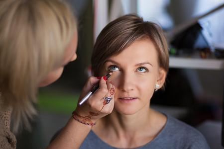 Makeup artist applying makeup products