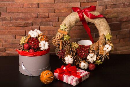 wall decor: Christmas decor and wreath on a brick wall background