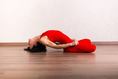 acrobatics: Pretty woman practicing yoga at home Stock Photo