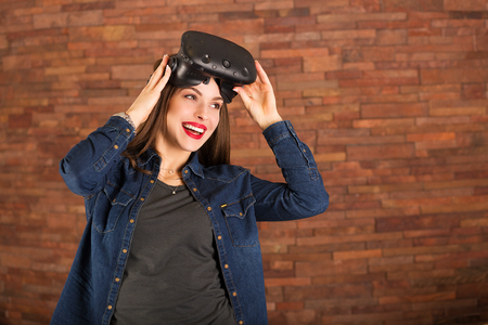 computer simulation: Young woman experiencing virtual reality glasses Stock Photo