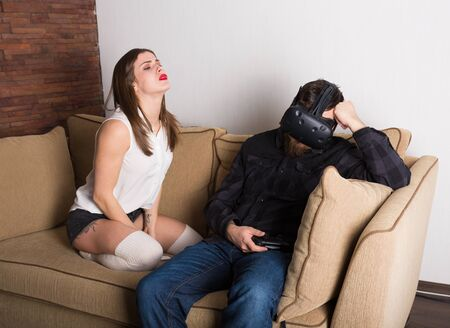 gamers: Couple of gamers at home with VR headset
