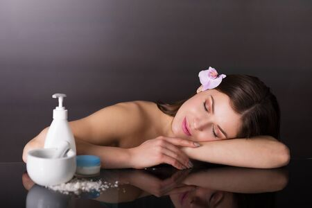 Beautiful young woman using a skincare products Stock Photo