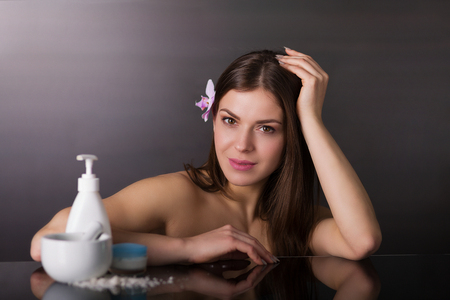 bandeau: Beautiful young woman using a skincare products Stock Photo