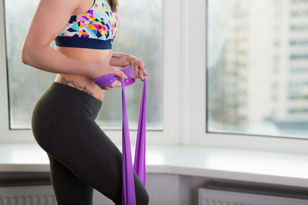 Beautiful young woman working out in the studio with elastic band Stockfoto
