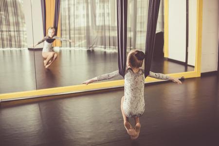 gaiters: Little dancer in a aerial yoga hammock in a dance studio