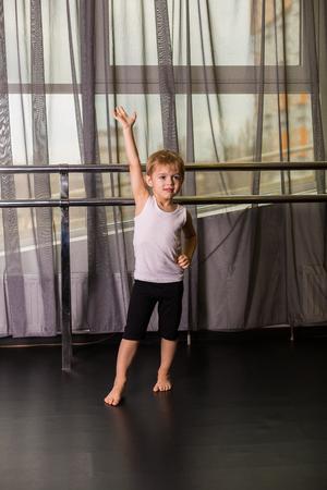 gaiters: Little boy dancer in a dance studio