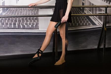 gaiters: Beautiful ballet dancer in a dance studio Stock Photo