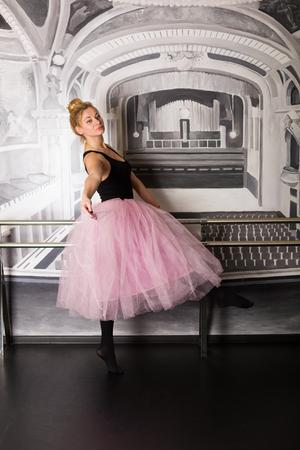 Pretty ballerina in pink tutu skirt training in the studio 版權商用圖片