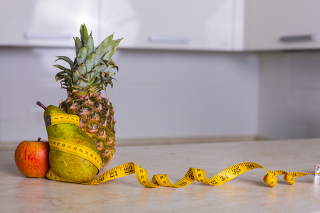 fat food: Bowl of fresh fruits in the kitchen Stock Photo