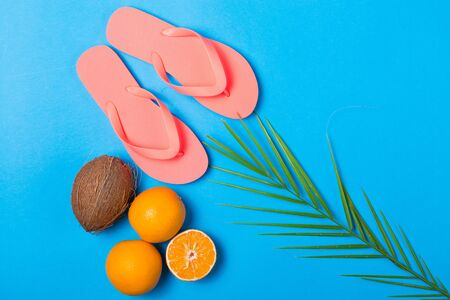 Summer essentials on a bright blue background Stock Photo