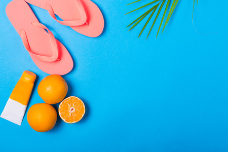Summer essentials on a colorful solid colour background