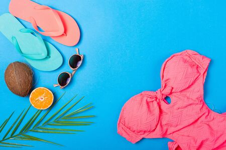 swimm: Summer essentials on a bright blue background Stock Photo