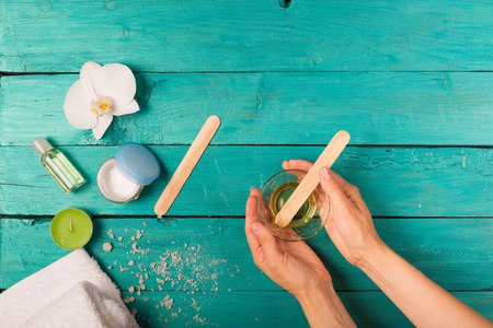 Skincare essentials bottles on a wooden background 스톡 콘텐츠