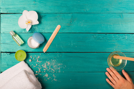 Skincare essentials bottles on a wooden background Stock Photo