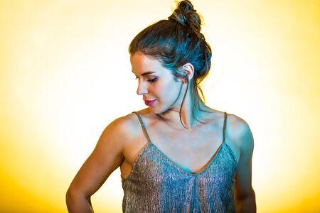 dancing club: Beautiful woman dancing and posing in bright disco lights