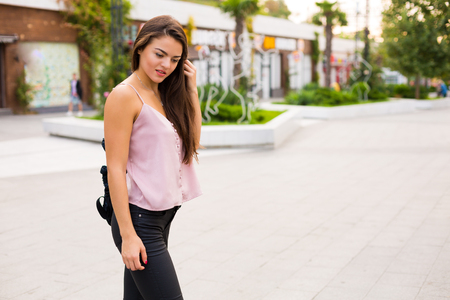 Beautiful woman walking in the summer city Stock Photo