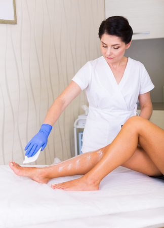 Woman cosmetologist working in a spa salon