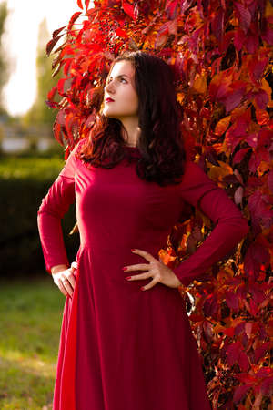 Beautiful woman walking alone in the autumn park Stock Photo