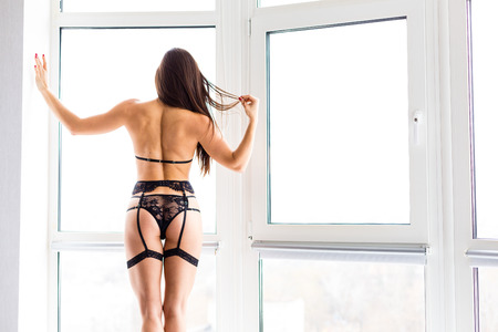 Sexy young woman wearing a lace lingerie set Stock Photo
