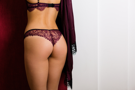 Woman in a lace lingerie showing her back Stock Photo