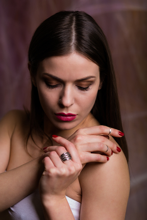 Beautiful young woman wearing a set of silver jewelry Stock Photo