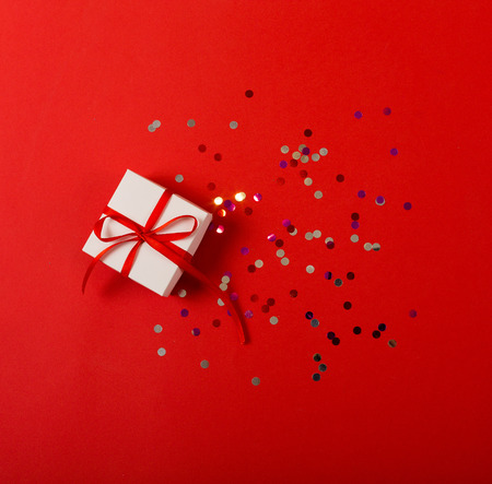 Present on a bright red background with a copy space
