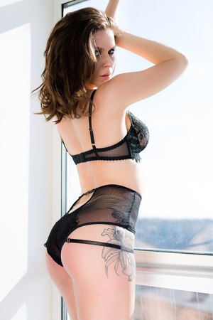 Beautiful woman posing in black lace lingerie Stock Photo