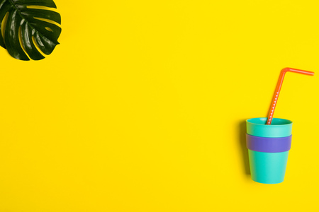 Bright summer background with a drinking straws