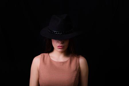 Beautiful woman wearing a wool hat. Retro style image